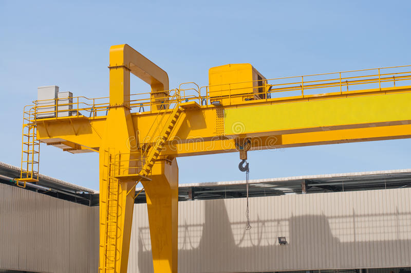 Yellow overhead crane royalty free stock photography