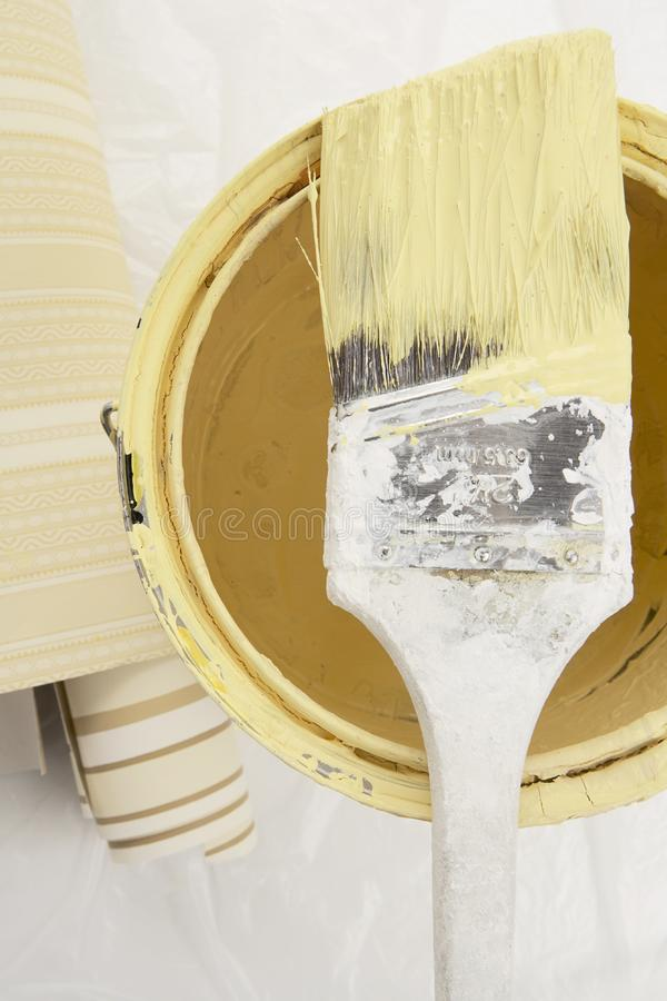 Yellow paint with brush royalty free stock photos