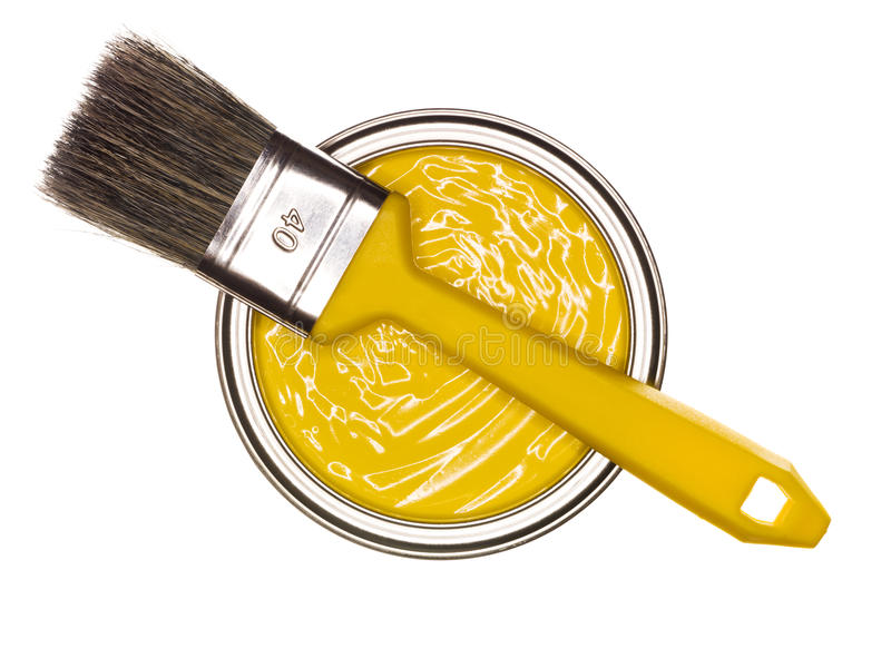 Yellow Paint can with brush stock photo