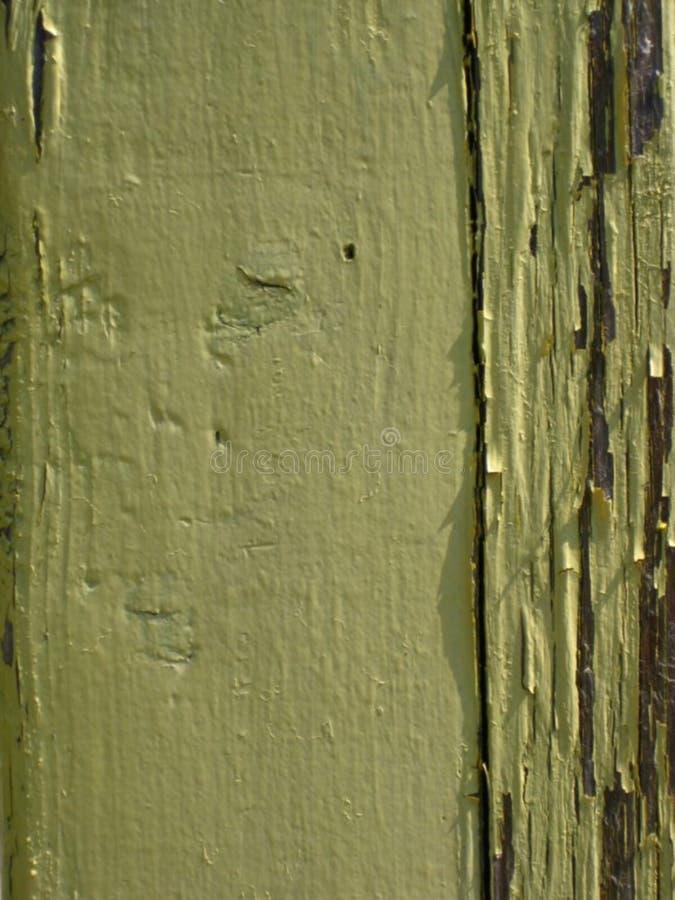 yellow-paint-peeling-off-wood stock image