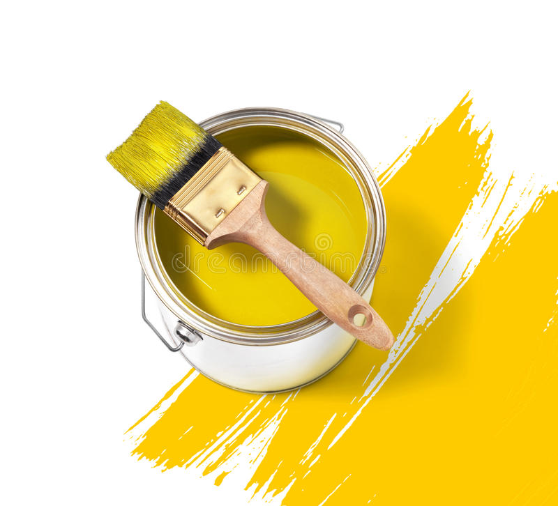 Yellow paint tin can with brush stock photo