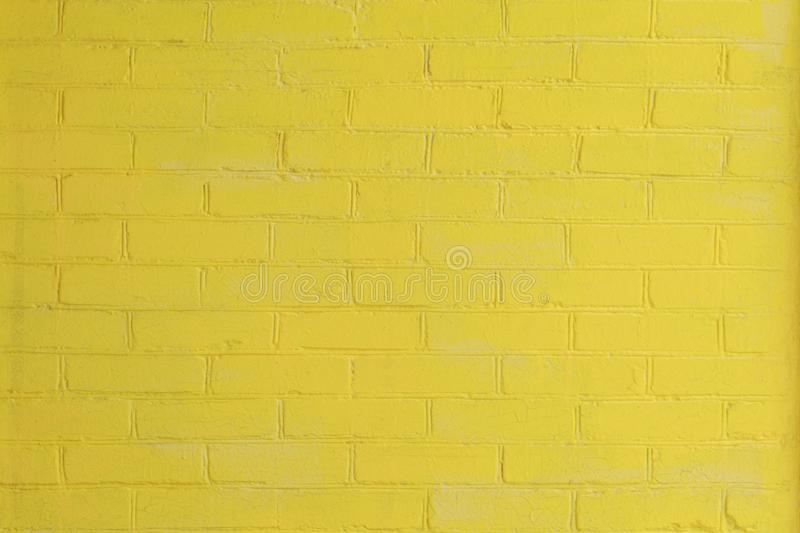 Yellow painted brick wall as a background or backdrop.  stock images