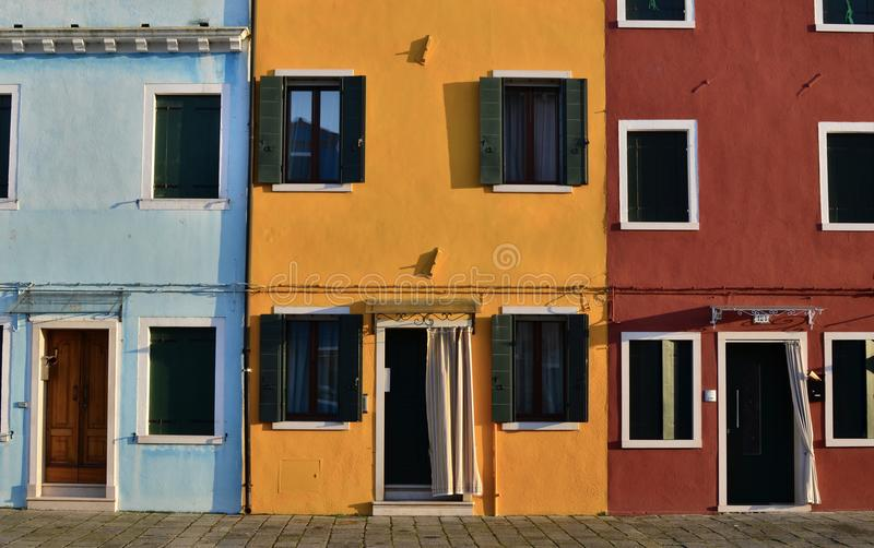 Yellow Painted Building Between Blue Painted Building On Left And Red Painted Building On Right Free Public Domain Cc0 Image