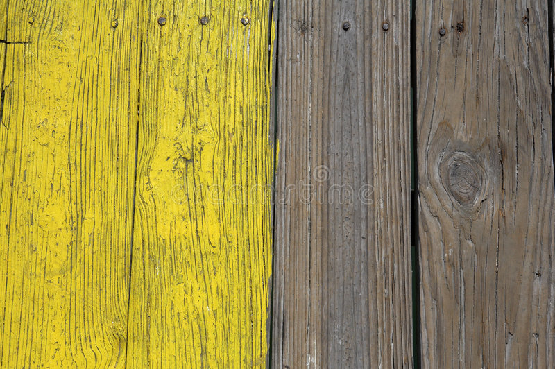 Yellow painted wooden planks stock photos