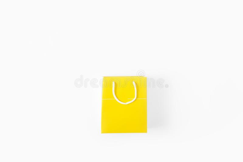 Yellow paper bag white background top view flat lay stock photography