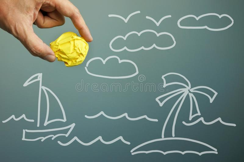Yellow paper ball as summer sun. Dreams about holiday and vacation royalty free stock photo