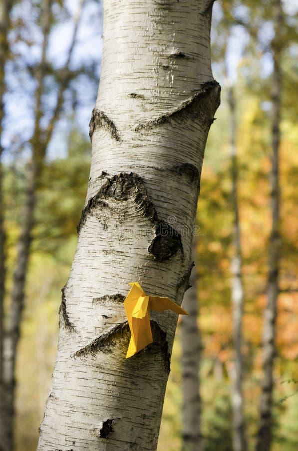 Yellow paper bird vertical shot. Selective focus stock photo