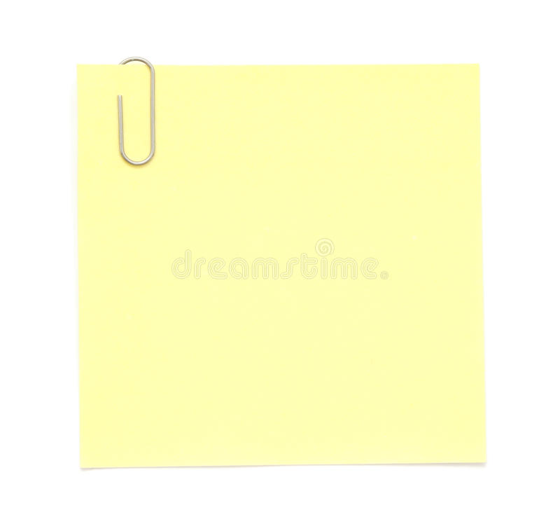 Yellow paper note with clip royalty free stock photo
