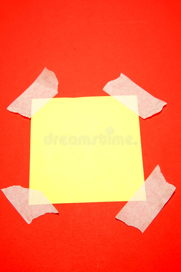 Download Yellow paper taped to red stock image. Image of paper - 5680601