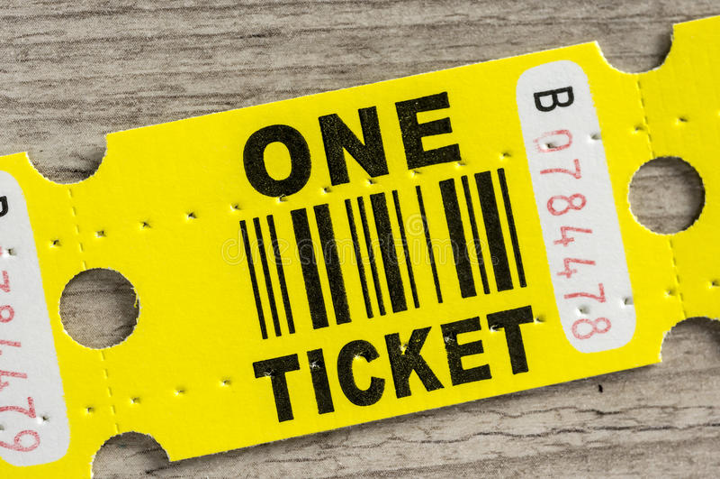 Yellow paper ticket stock photo