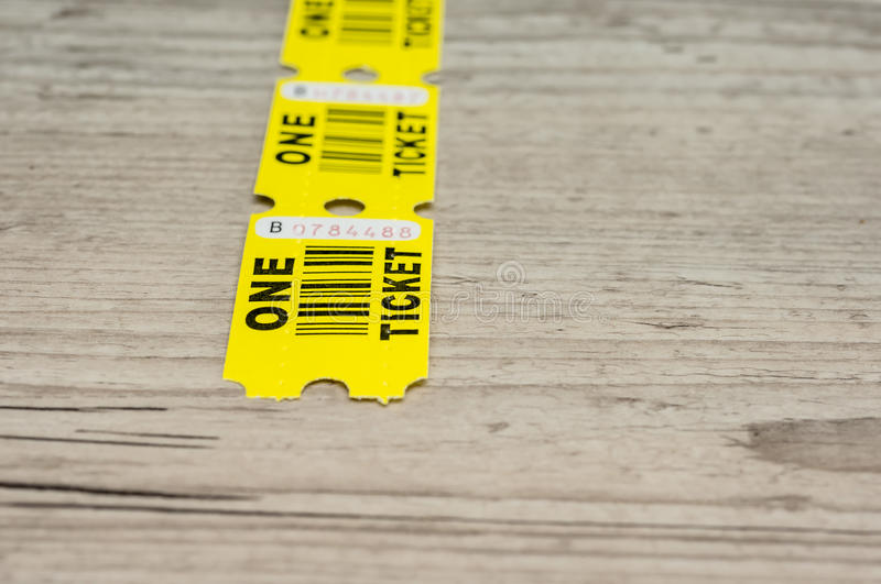 Yellow paper tickets royalty free stock photos