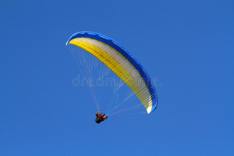 Yellow paraglider stock photography