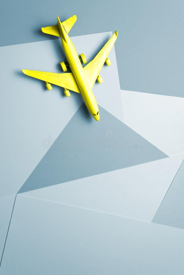 Yellow passenger jet airplane, travel minimal idea. multicolor paper funny background. Yellow passenger jet airplane, minimal concept, multicolor paper funny royalty free stock photos