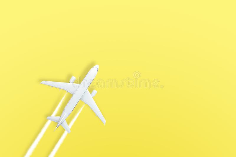 Yellow pastel paper airplane on background. Minimal concept.  royalty free stock images