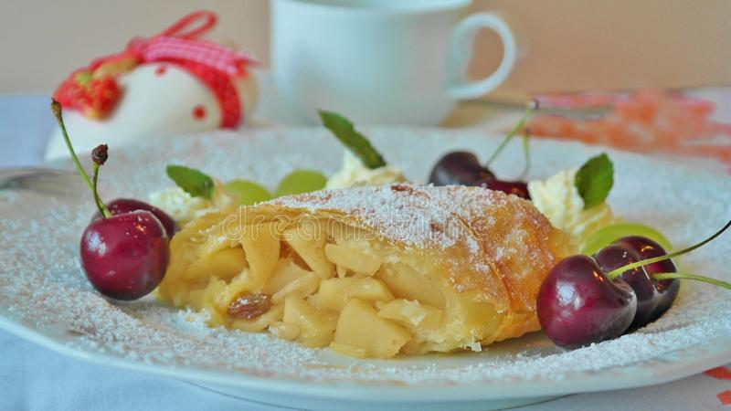 Yellow Pastry and Red Cherry in White Ceramic Dining Plate stock photography