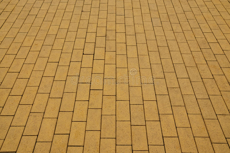 Yellow paving slabs. Sidewalk, paved with yellow tiles. Beautiful background stock images