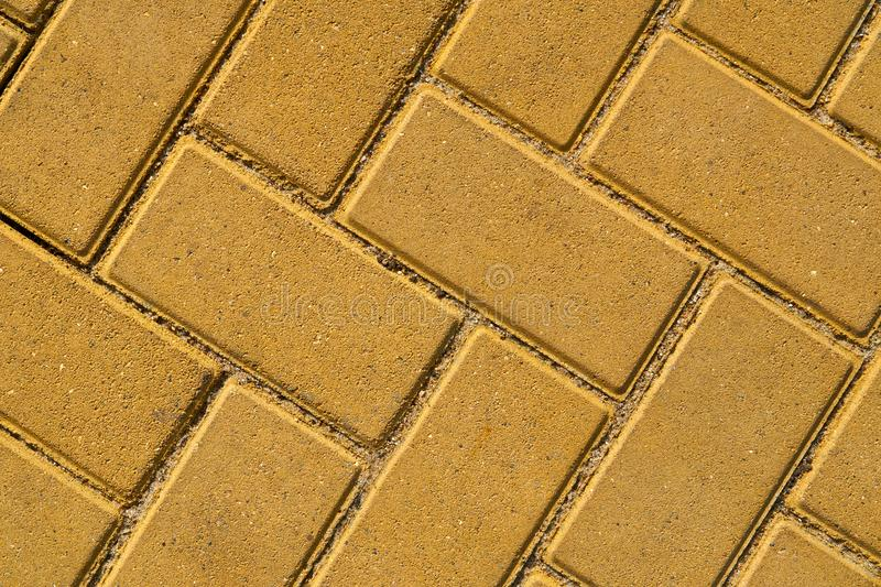 Yellow paving tile for background or texture royalty free stock image