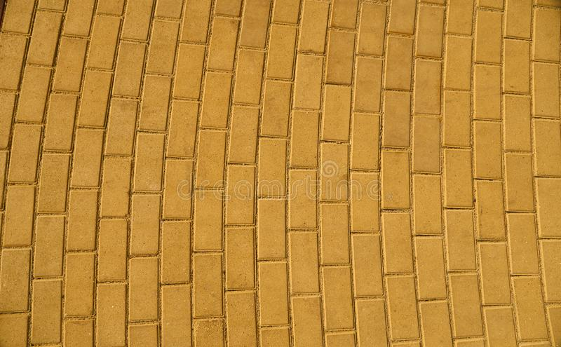 Yellow paving tile for background or texture stock photo