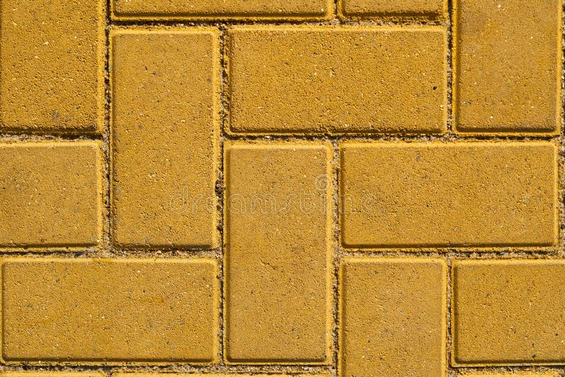 Yellow paving tile for background or texture royalty free stock photos