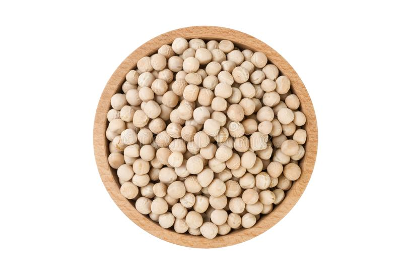 Yellow pea in wooden bowl isolated on white background. nutrition. food ingredient.  stock photography