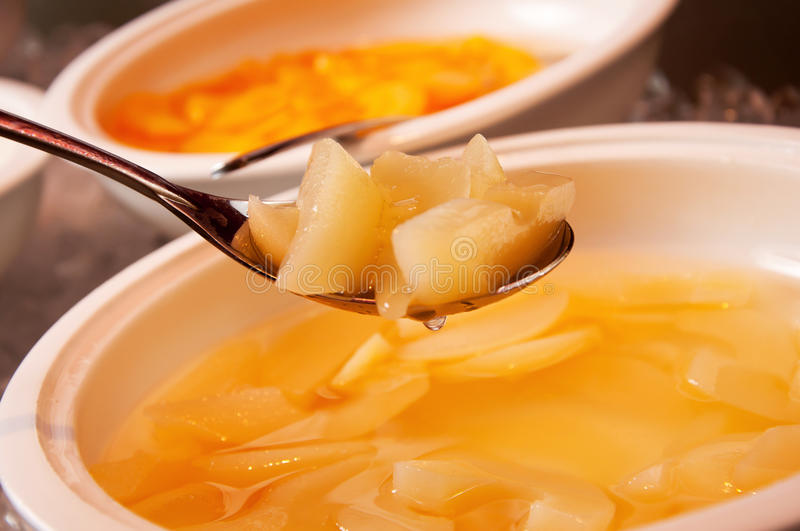 Yellow peach in syrup royalty free stock photography