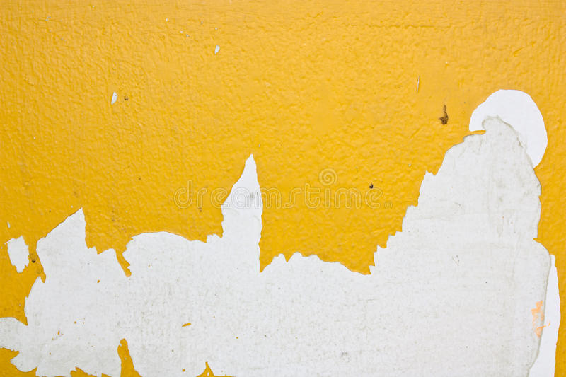Yellow peel off from the surface of the plaster. Suitable for background stock photo