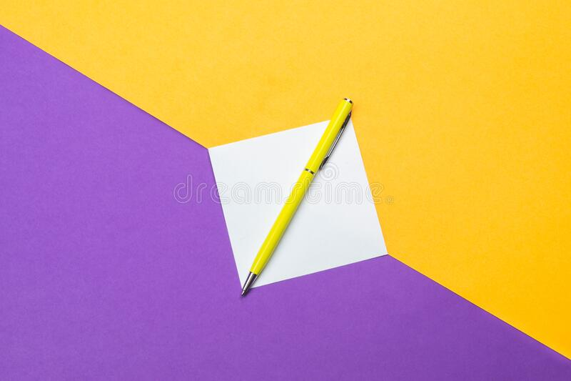 Yellow pen and note on colored background. Yellow pen and white note on colored background royalty free stock photography