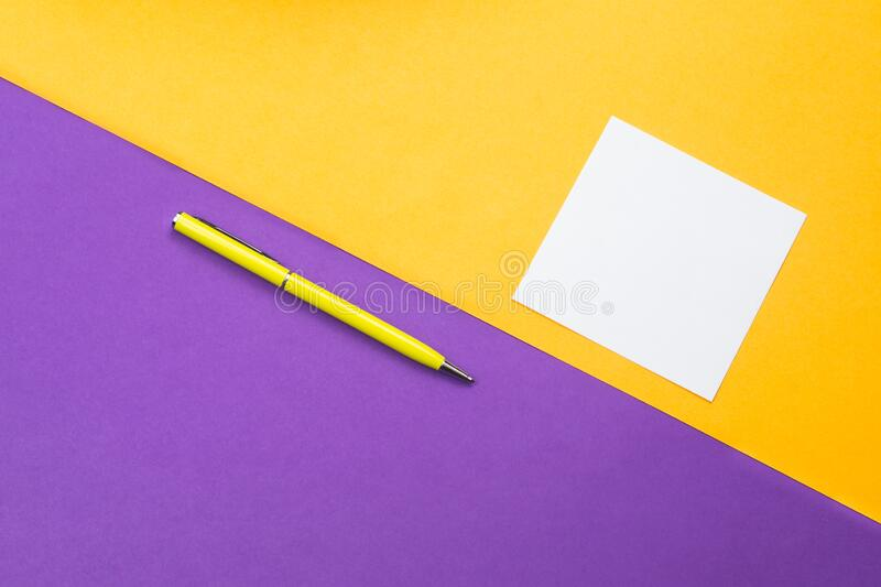 Yellow pen and note on colored background. Yellow pen and white note on colored background stock photography
