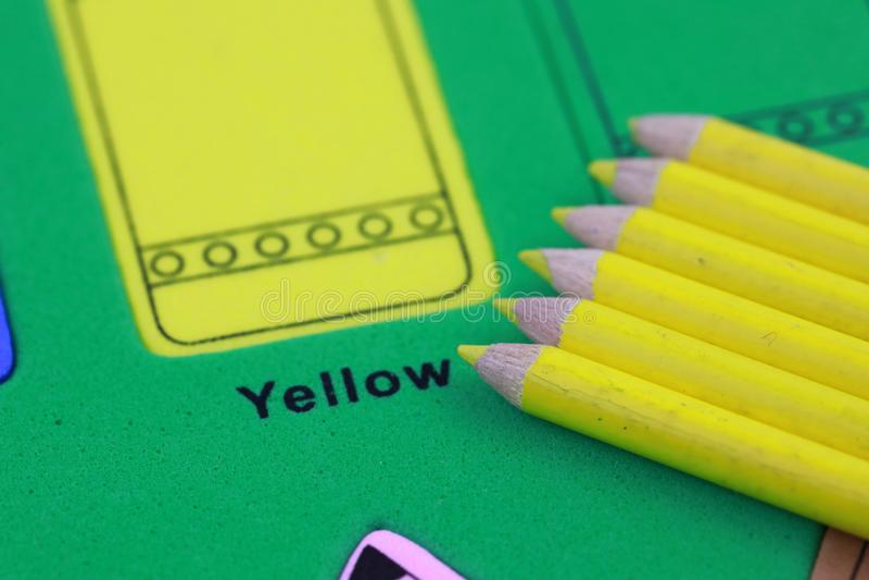 yellow pencil crayon stock images