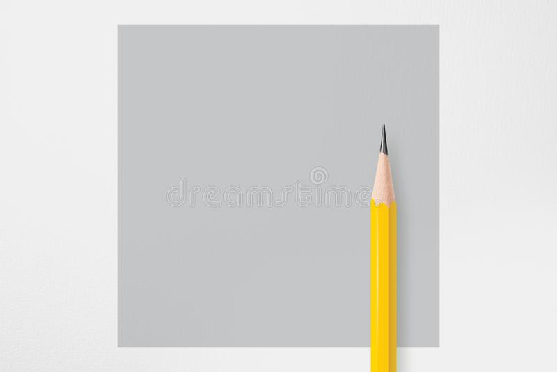 Yellow pencil with gray circle stock images