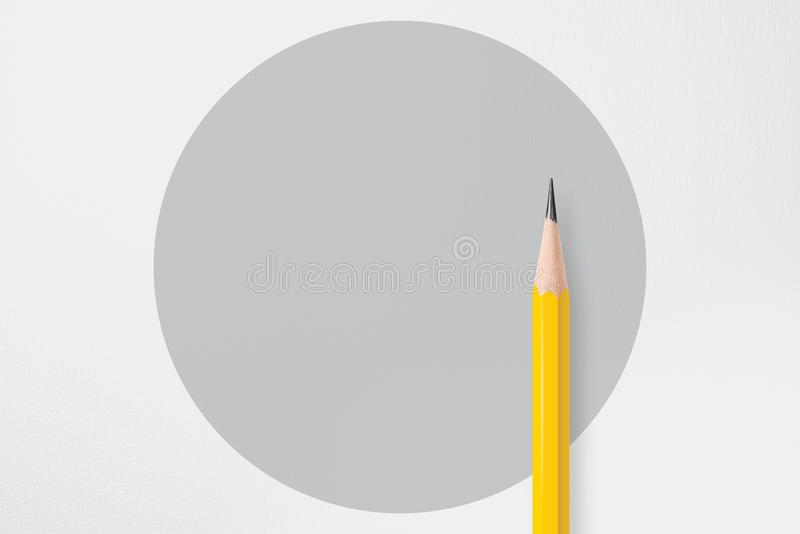 Yellow pencil with gray circle stock photography