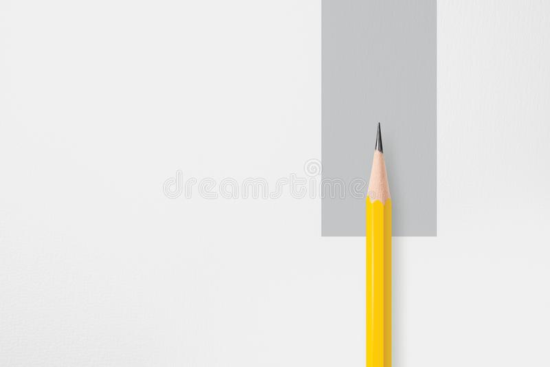 Yellow pencil with gray circle stock photo