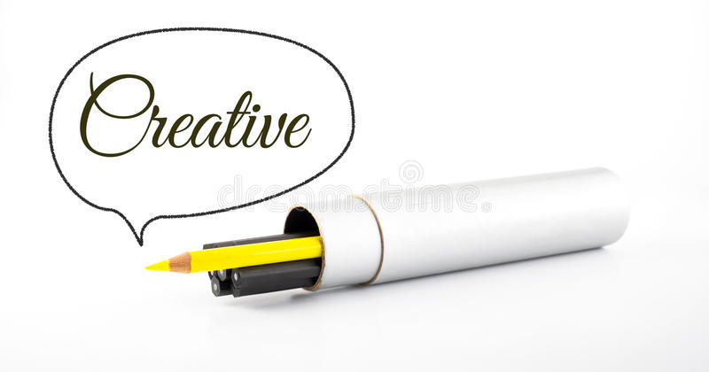 Yellow pencil outstanding from black pencil with speech bubble a royalty free stock photo