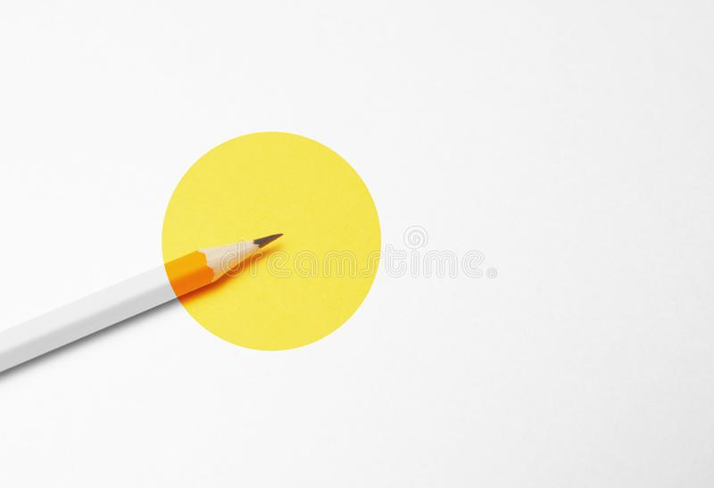 Yellow pencil on white background, minimalism. Creativity, idea, solution, creativity concept.  royalty free stock photography