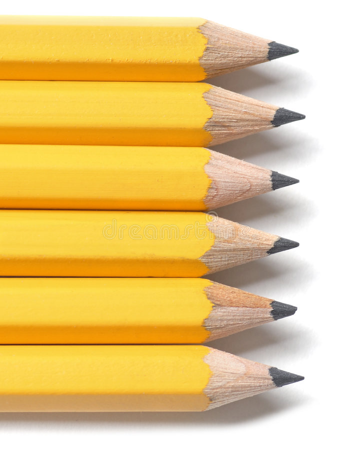 Yellow Pencils. Line of sharpened yellow pencils royalty free stock images