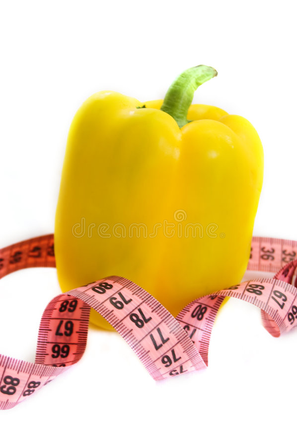 Yellow pepper. With measuring tape isolated on white royalty free stock photo