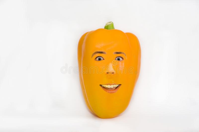 Yellow pepper with a human face, genetically modified foods. Food monsters with eyes and mouth stock photography