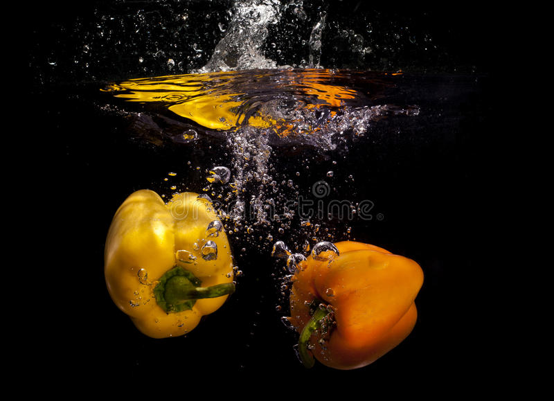 Download Yellow peppers in water stock image. Image of peppers - 22450849