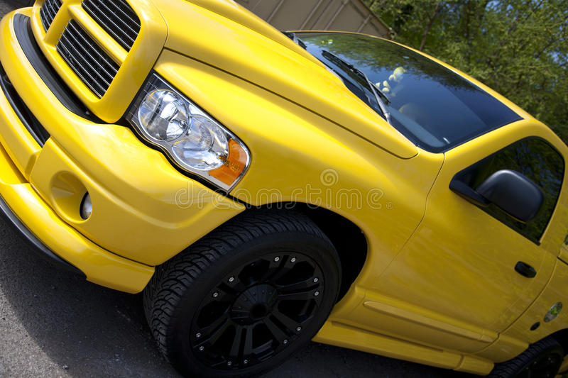 Yellow pick up truck. Bright yellow American pick up truck royalty free stock photography