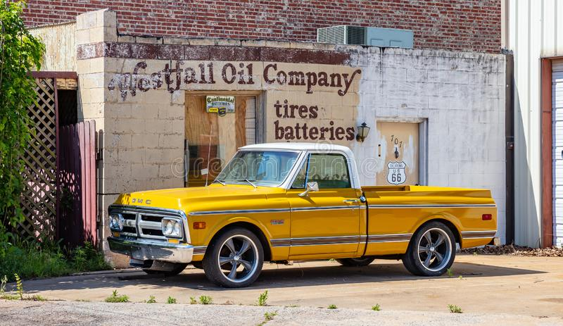 Yellow pickup car parked outdoors in a sunny spring day. USA. USA Oklahoma, May 13th, 2019. Yellow color GMC pickup car parked outdoors in a sunny spring day stock photos