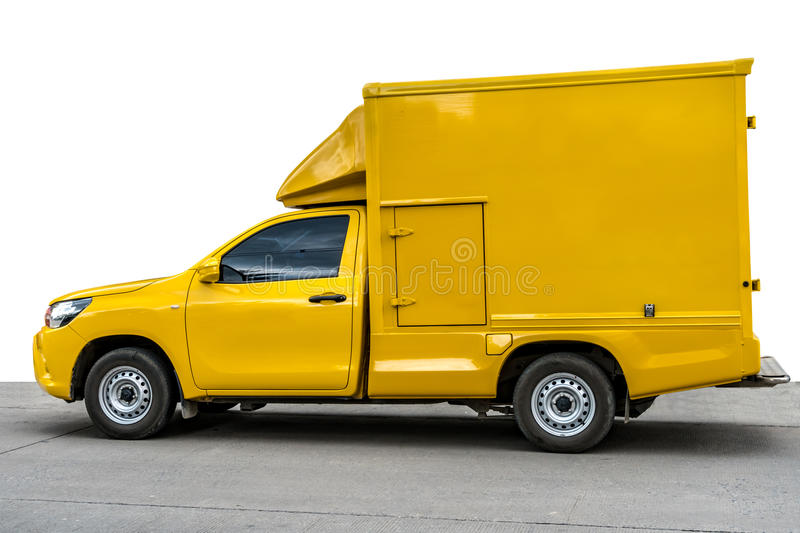 Yellow pickup truck with container royalty free stock images