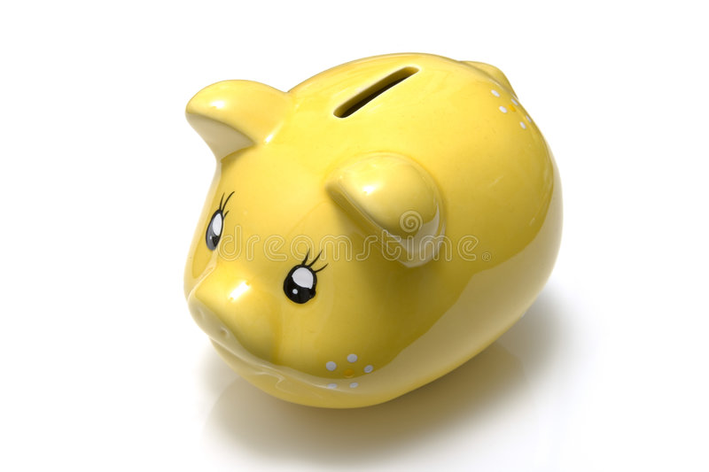 Yellow piggy bank royalty free stock photography
