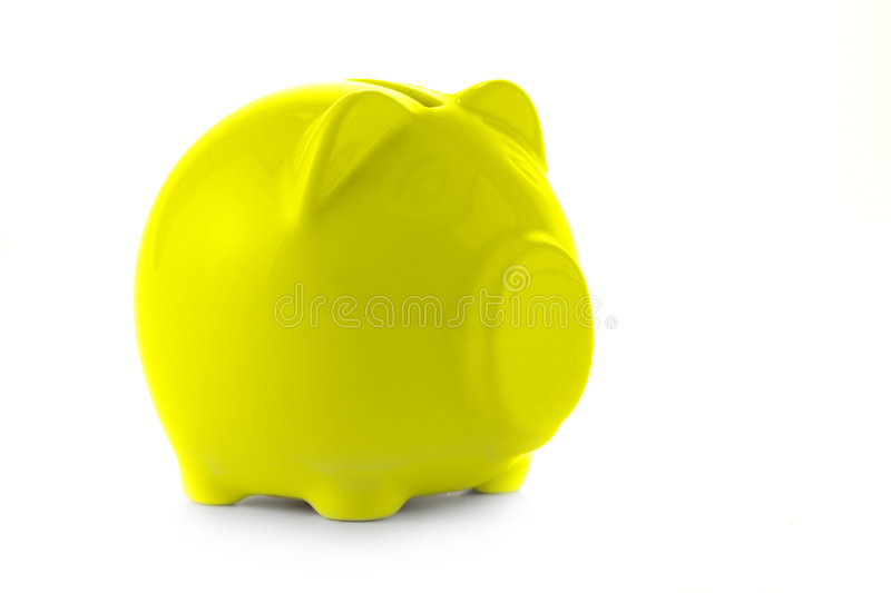 Yellow piggy bank royalty free stock photo