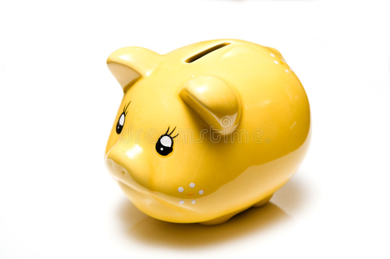 Yellow piggy bank. Closeup of ceramic yellow piggy bank isolated on white background royalty free stock image