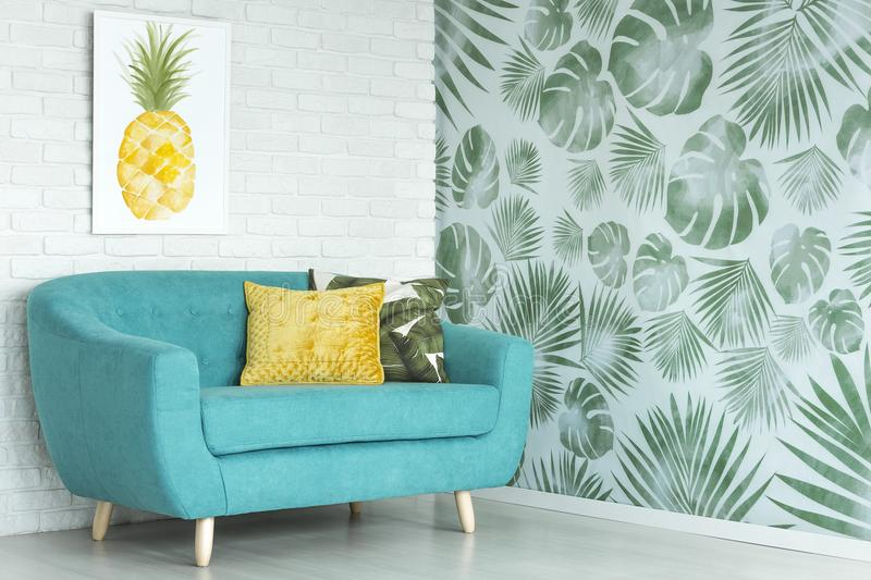 Pineapple poster in living room royalty free stock images