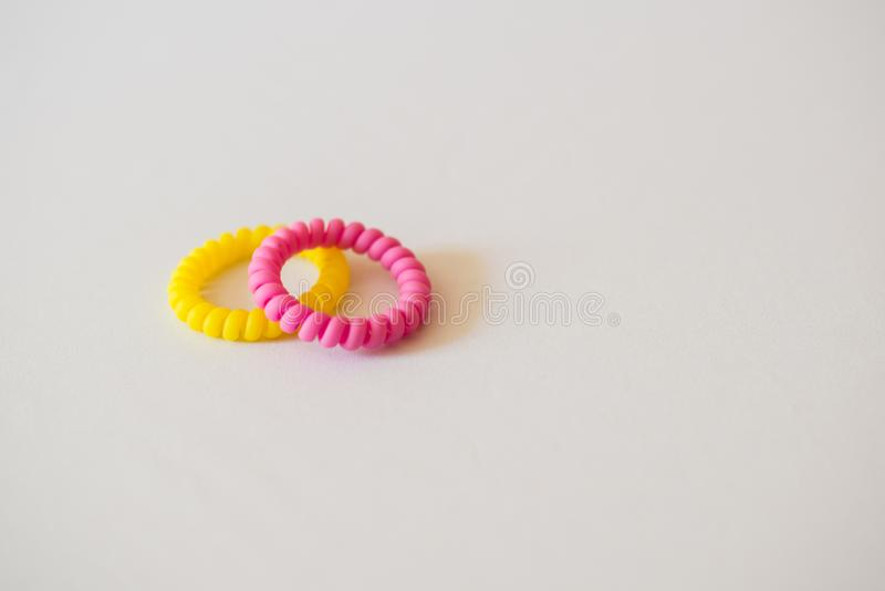 Yellow pink hair band on white background. Scrunchy for hair on white background royalty free stock photos