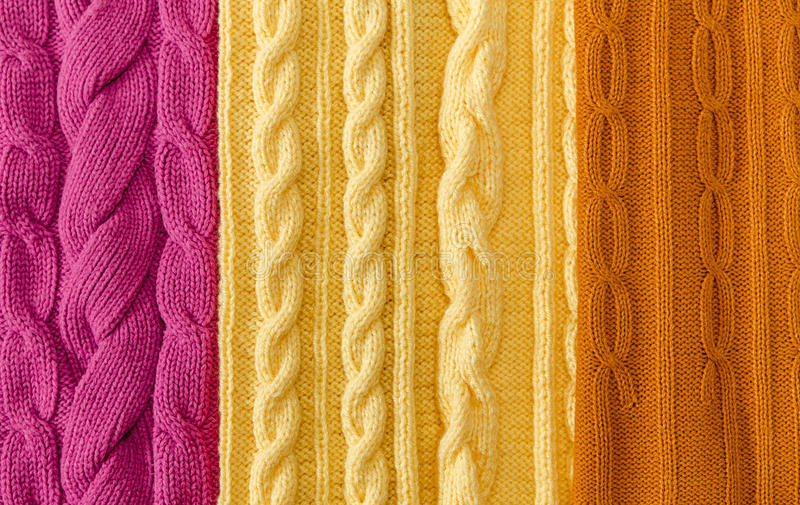 Yellow;Pink and Mustard-Yellow Knitted Items with Braids and Pattern.Hand Made;Fancywork royalty free stock image