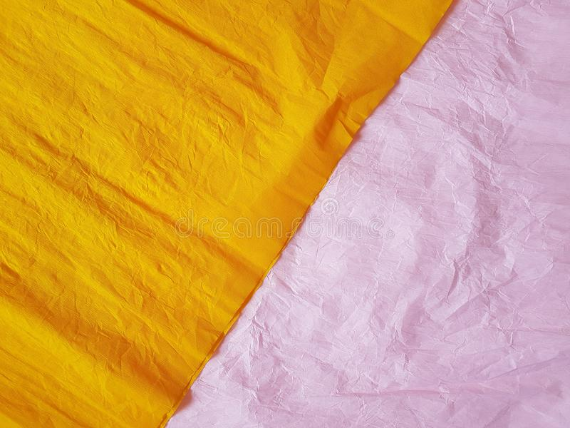 Yellow pink paper background silk surface empty blank sheets vivid colors. Wrapping royalty free stock images