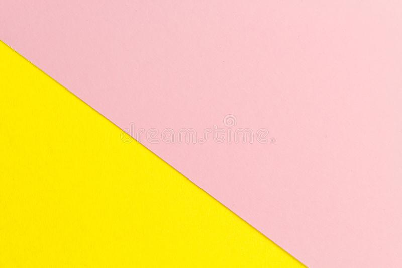 Yellow and pink paper texture background Color. Trending colors, geometric background of the paper. Colorful soft paper background. Pastel color stock image