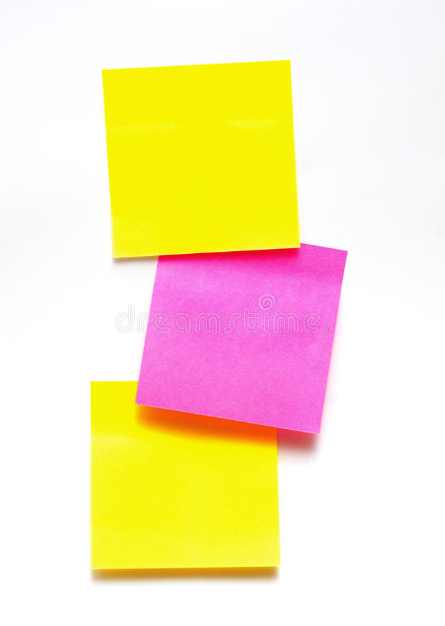 Yellow and pink stickers on a white background royalty free stock images
